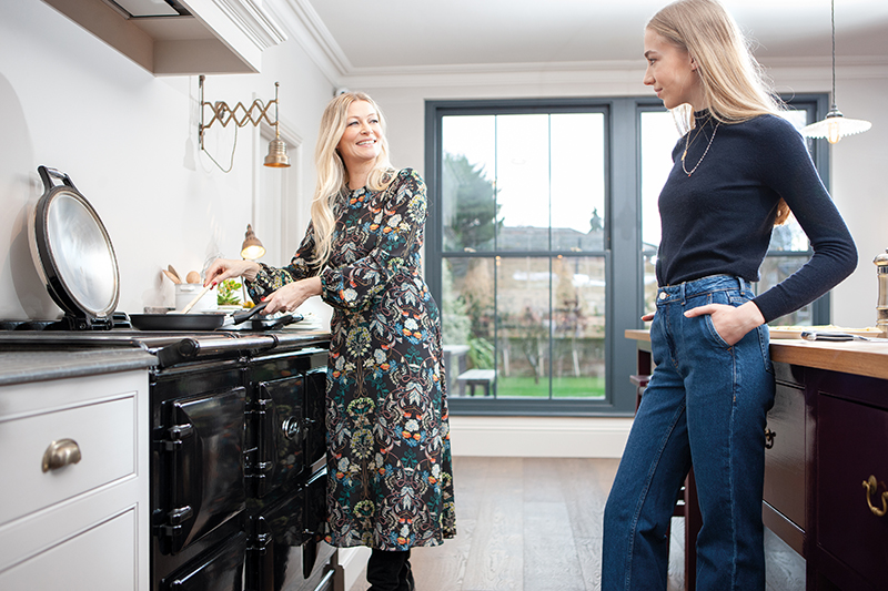 Mother and daughter cook on an AGA cooker
