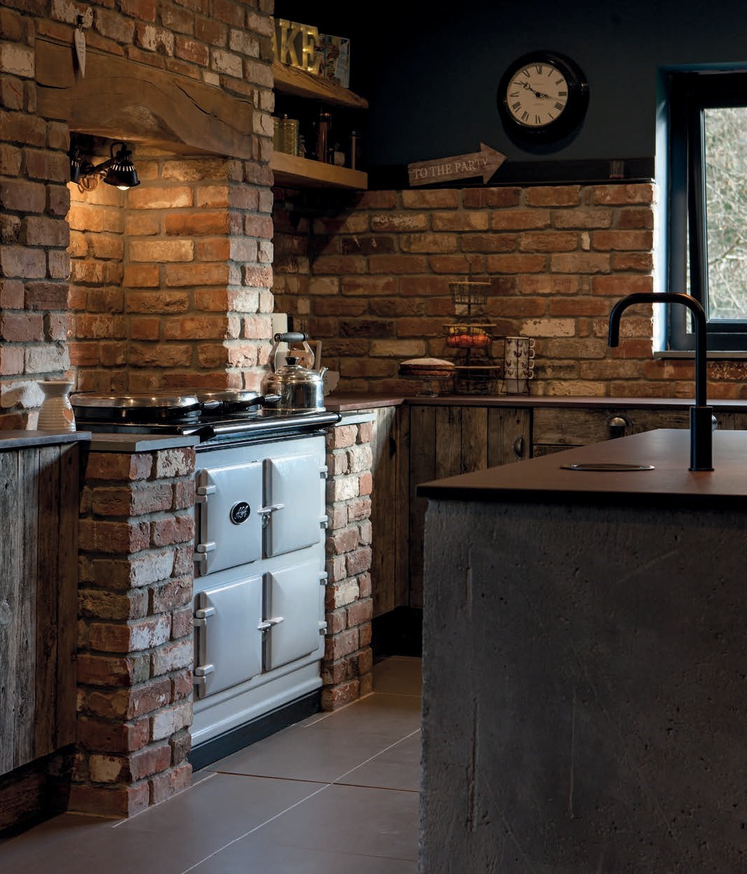 AGA Dual Control in Pearl Ashes with brick walls