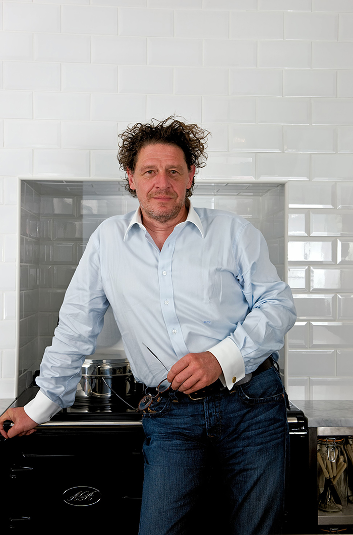 Marco Pierre White in his kitchen