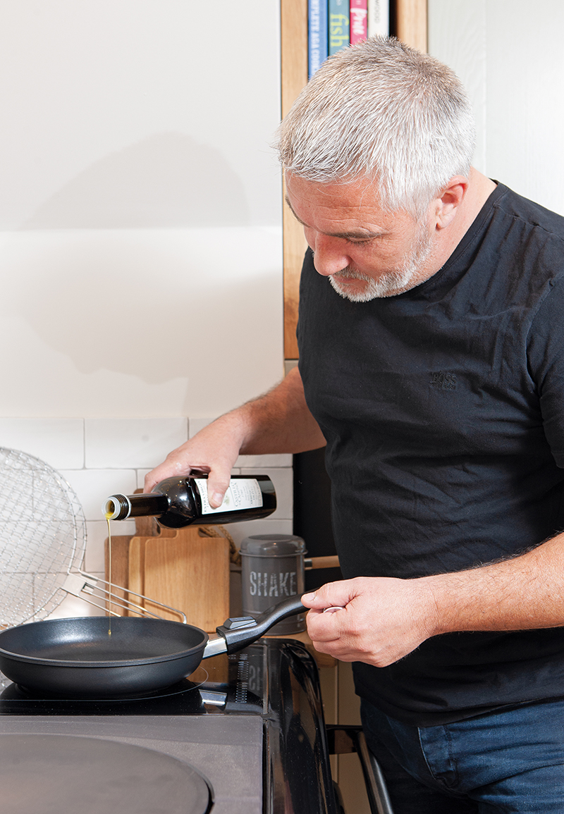 Paul Hollywood cooking on his AGA