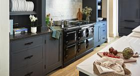 AGA R7 150 in Black with dark blue cabinetry