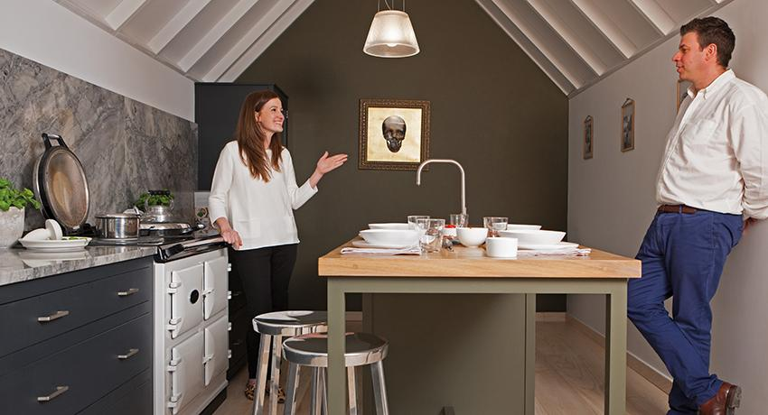 Gemma and Jasper in front of the AGA Dual Control in White in Middleton Bespoke kitchen