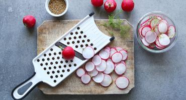 Radishes on a chopping board