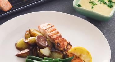 Grilled salmon, potatoes, green beans and a hollandaise sauce