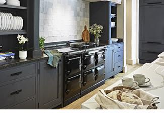 AGA 7 Series cooker in Black with blue cabinetry