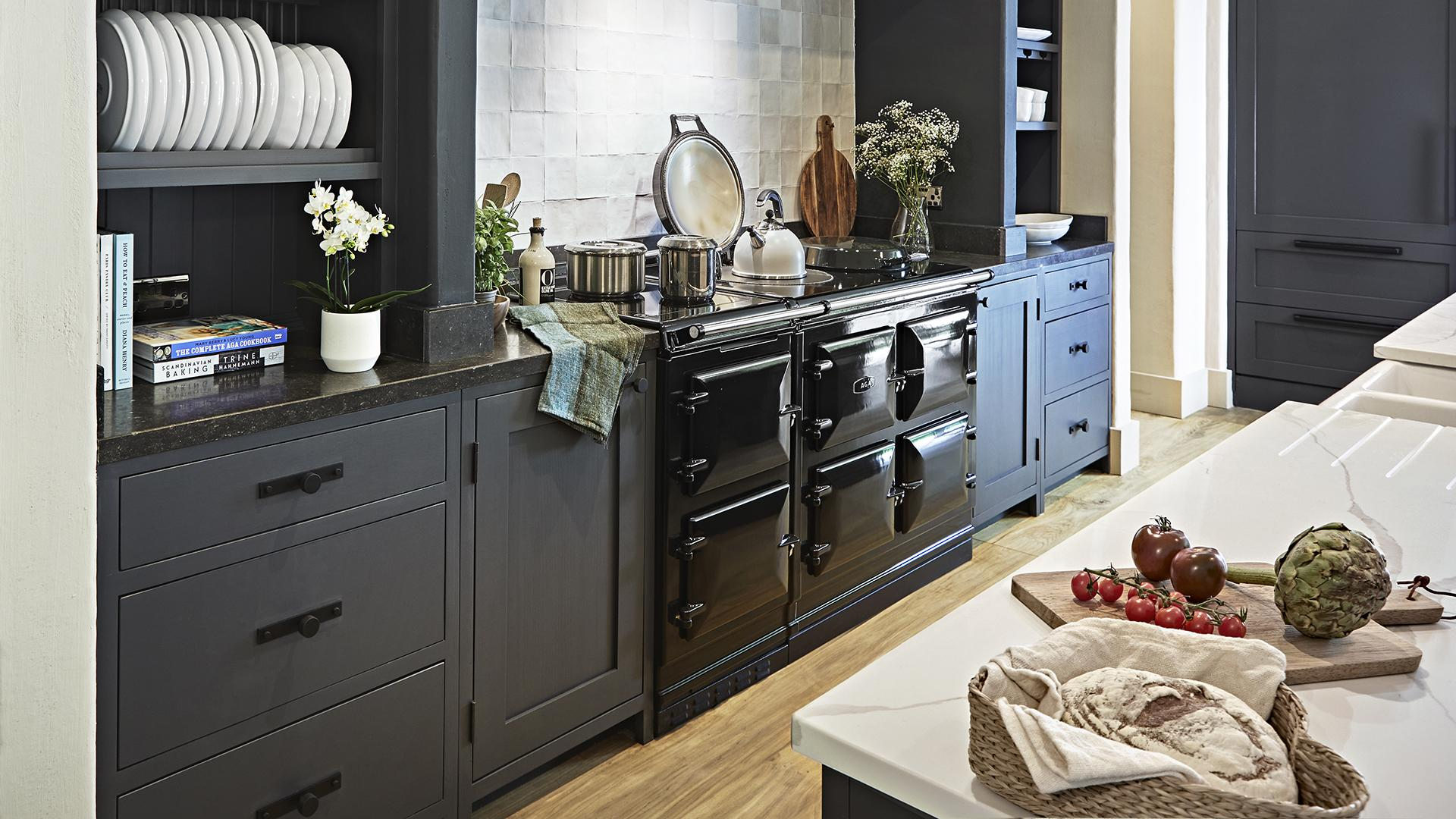AGA 7 Series 150 cooker in Black with blue cabinetry