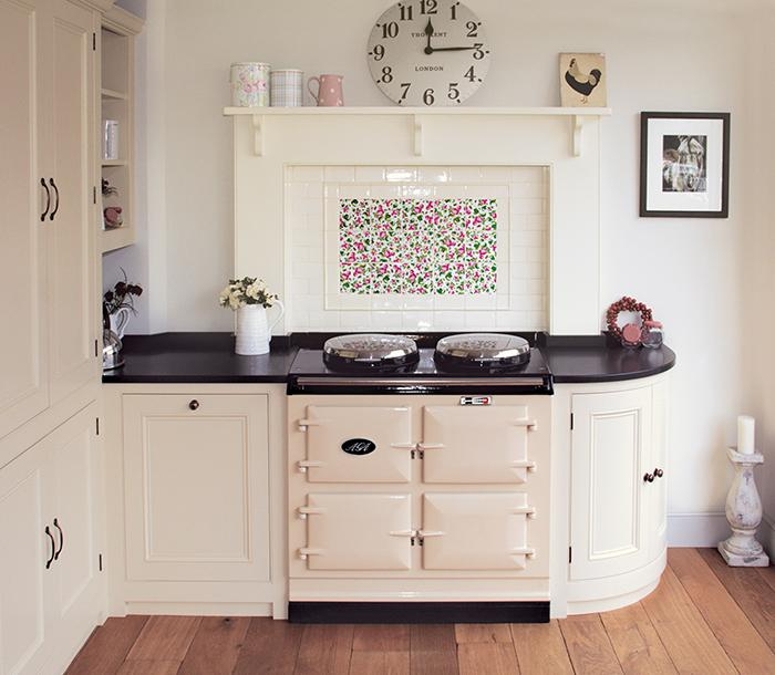 Cream 3 oven 13 amp AGA cooker in kitchen with floral tiled splashback