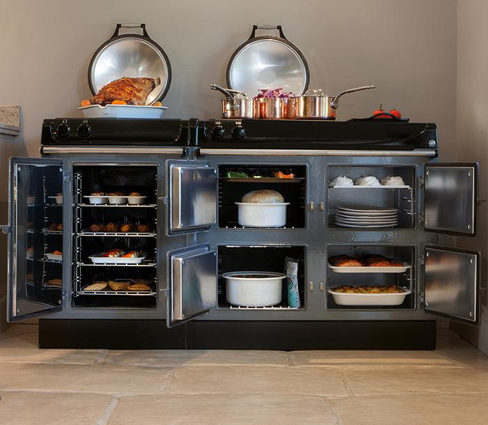 AGA eR3 Series 170cm cooker with open doors and AGA Cookware