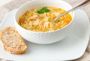 Chicken Noodle Soup in bowl with bread